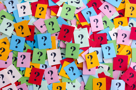 asking: Too Many Questions. Pile of colorful paper notes with question marks. Closeup. Stock Photo