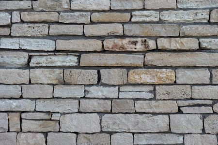overbuilding: Stone wall background. Close up.