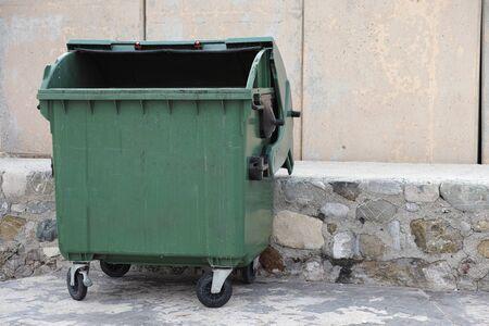 dumpster: Green empty trash dumpster. Close up.