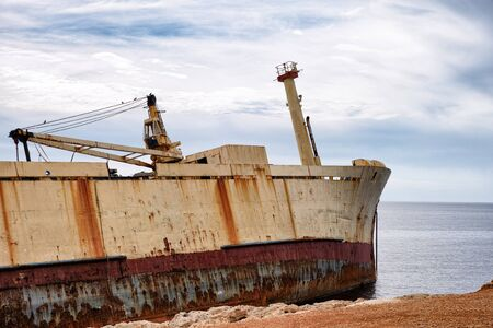 old ship: Abandoned wreck old ship near shore.