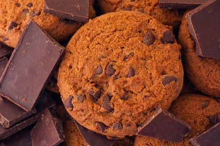 chocolate pieces: Homemade chocolate chip cookies and pieces of broken chocolate. Close up.