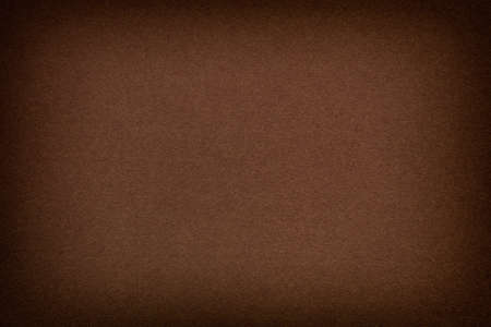 vignette: Brown paper background with vignette. Stock Photo