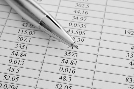 Financial statements. Ballpoint pen on financial statements. Black and white image. Close up.