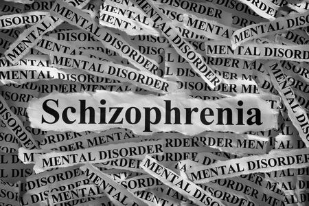 psychosocial: Schizophrenia. Torn pieces of paper with the word Schizophrenia and mental disorder. Concept Image. Black and White. Closeup. Stock Photo