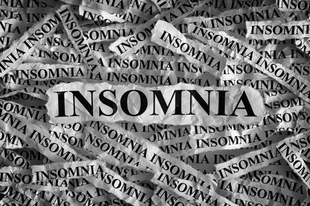 sleeplessness: Insomnia. Torn pieces of paper with the word Insomnia. Concept Image. Black and White. Closeup.