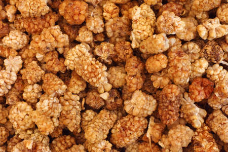 sun dried: Sun dried white mulberries background. Close up.