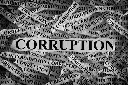 corruptible: Torn pieces of paper with the word Corruption. Concept Image. Black and White. Closeup. Stock Photo