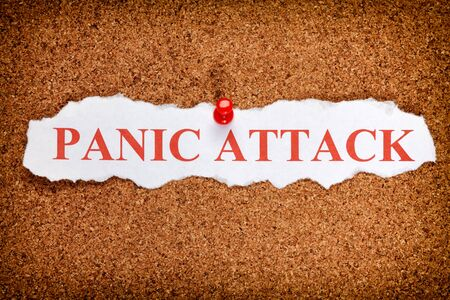 panic attack: Torn piece of paper with words Panic Attack Stock Photo