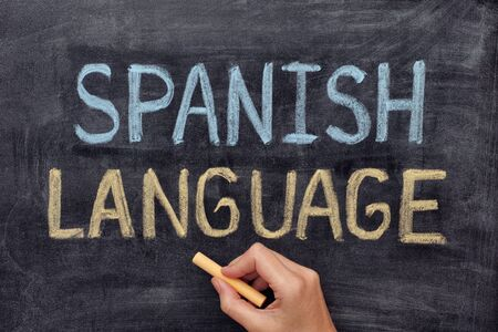 spanish language: Spanish language. Hand drawing Spanish Language on blackboard. Close up.