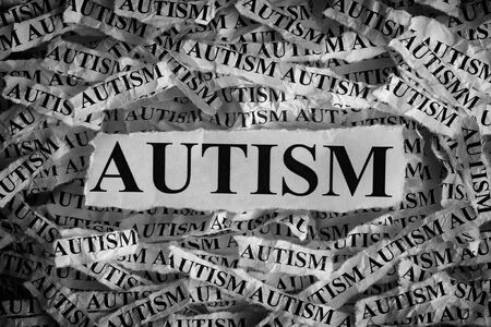 prognosis: Autism. Torn pieces of paper with the word Autism. Concept Image. Black and White. Closeup. Stock Photo