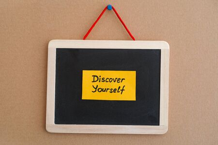 discover: Phrase Discover Yourself on blackboard. Close up. Stock Photo