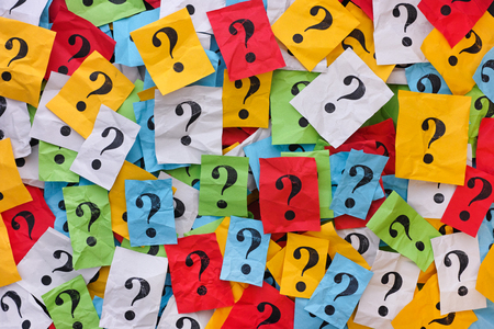 too many: Too Many Questions. Pile of colorful paper notes with question marks. Closeup. Stock Photo