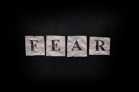 fear: Word Fear on a blackboard. Close up. Stock Photo