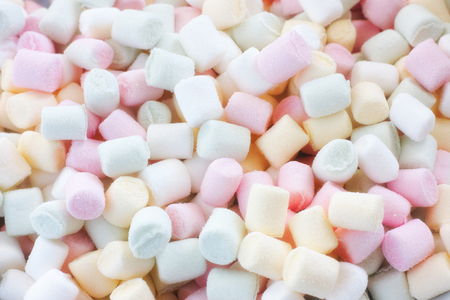 Colourful marshmallow candy background. Close up.