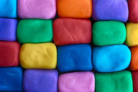 Colorful blocks made out of plasticine. Plasticine wall. Close up. Stock Photo