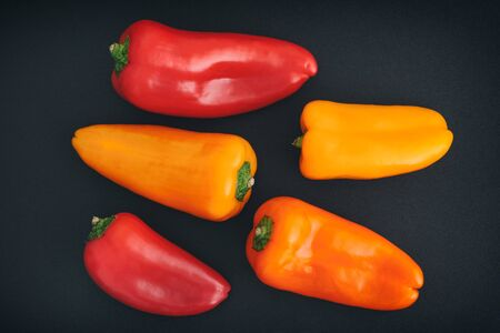 Bell peppers on a black background. Close up. Stock Photo