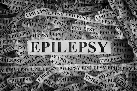 Epilepsy. Torn pieces of paper with the words Epilepsy. Concept Image. Black and White. Closeup. Stock Photo