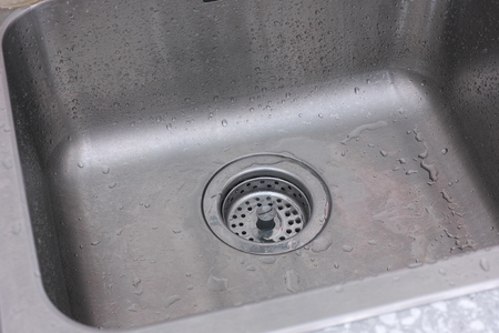 Drain of kitchen sink. Close up. Stock Photo