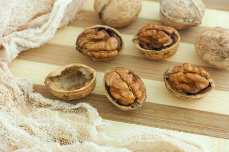 Organic walnuts on a wooden table. Close up. Stock Photo