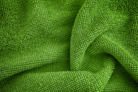 Dark green towel texture background. Close up.