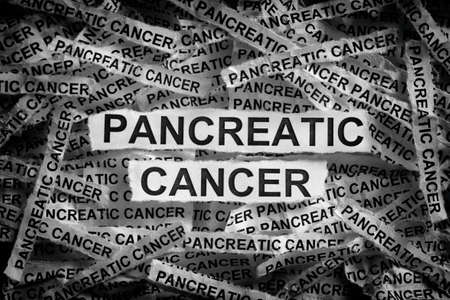 Pancreatic cancer. Torn pieces of paper with the words Pancreatic cancer. Black and white. Close up.