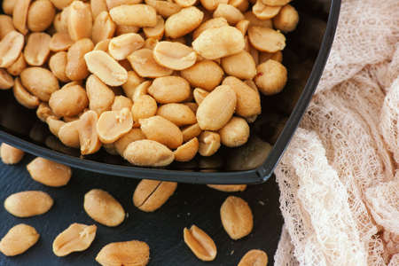 Salted roasted peanuts. Close up.