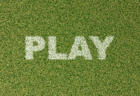 grass field: realistic textured grass football - soccer field. PLAY - written with white grass on the green football field Stock Photo