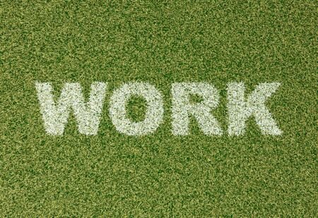 field work: realistic textured grass football - soccer field. WORK - written with white grass on the green football field Stock Photo