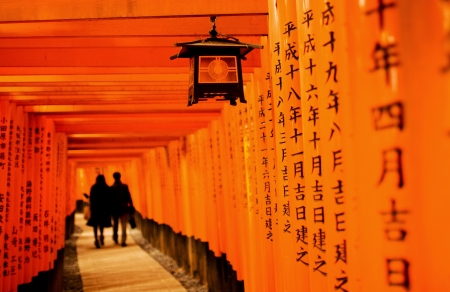 Inside the tunnel of Japanese Torii Gates at Fushimi Inari Taisha , Kyoto Japan