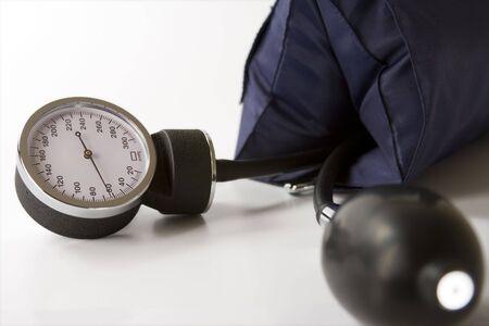 blood pressure gauge: Sphigmomanometer. Blood pressure gauge on a white background