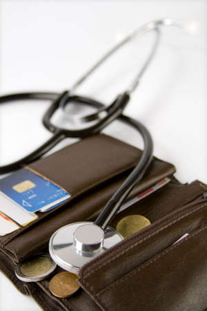 card holder: Brown card holder with a stethoscope checking it on a white background.