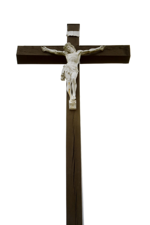 White Jesus on a wooden cross. Vertical shot. photo