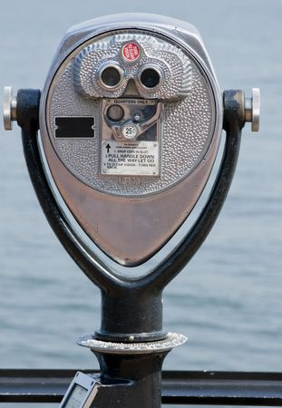 telezoom: Glasses to watch the lanscape. Vertical shot. Stock Photo