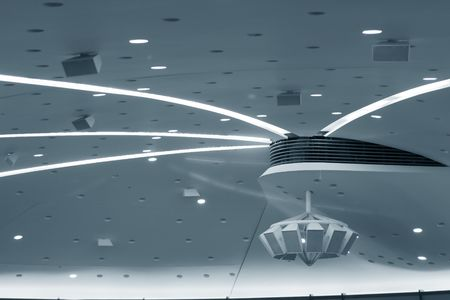 taint: White conference room ceiling with speakers. Blue taint.