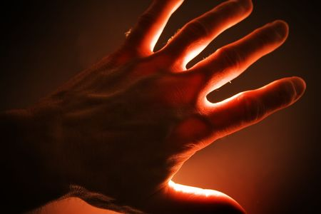 irradiate: Hand with red light effect. Horizontal shot. Stock Photo