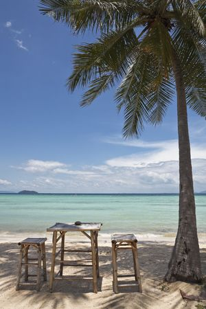 exotism: Bamboo table and chairs on a beautiful beach in thailand. Ko phi phi island.