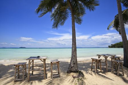 Bamboo table and chairs on a beautiful beach in thailand. Ko phi phi island.