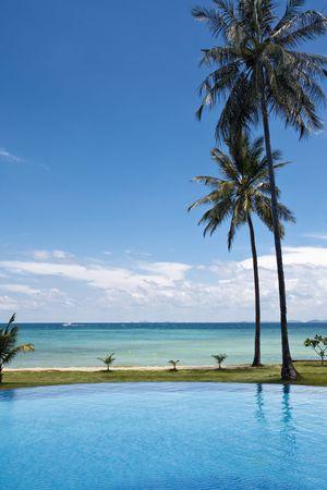 exotism: Beautiful swimming pool next to a beach in thailand. Ko phi phi island.