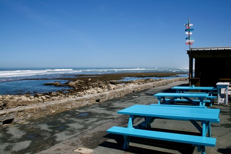 blue benches on the Basque coast in Biarritz Stock Photo
