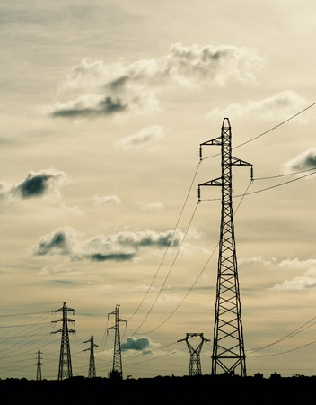 electric pylon and power lines with cloudy sky