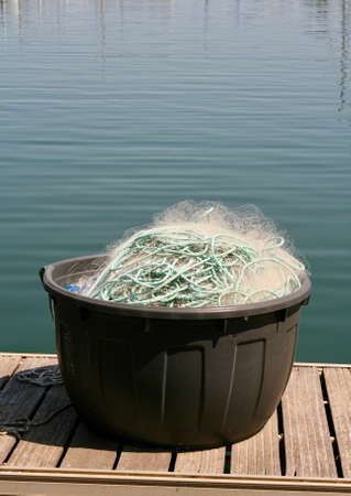 fishing net on the pontoon of a Mediterranean port