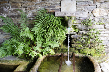 Village fountain, fresh spring water and drinking water Banco de Imagens - 84336130
