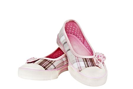 Isolated children's shoes on white
