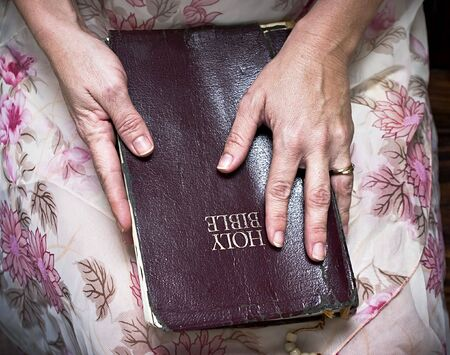 woman holding a Bible in her lap Stock Photo - 4172593