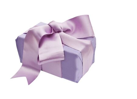 Gift box wrapped with wrapping tissue and a satin bow isolated on a white background Stock Photo