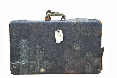 Vintage suitcase with old airline tag isolated on a white background. Reklamní fotografie