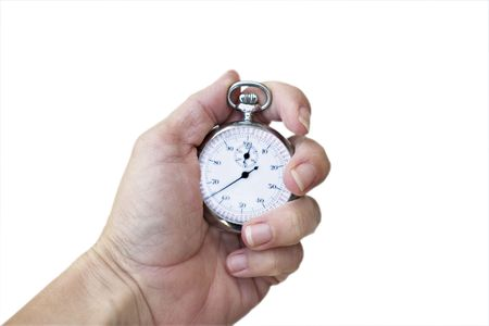 elapsed: Womans hand holding a stopproduction watch Stock Photo