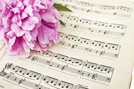 sheet music: Sheet music and flowers