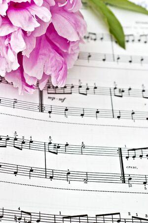 sheet music: Sheet music and flowers