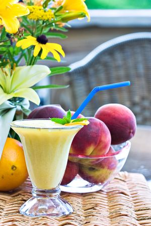 Orange Julius with fresh fruit in an outdoor setting